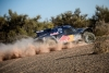 Sainz dips his wheels in the sand on Stage Five